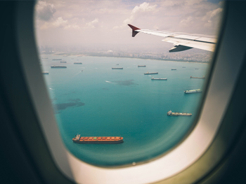 Cargo Ships in view from an airplane