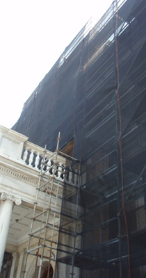 Scaffolding covered with debris netting