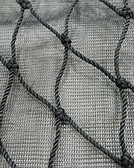 Fall safety netting with debris net liner