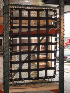 EZ Barrier Net in use securing a shelving unit