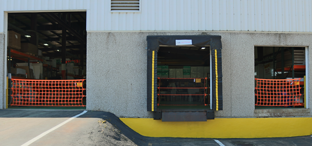 Three loading dock doors with our dock safety barriers in place