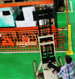 A warehouse barrier net system in use at our facility.