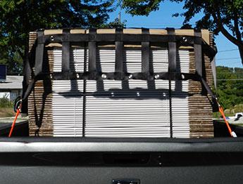 truck bed cargo net fastening system